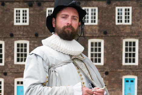 Live Interpreter dressed as Sir Walter Raleigh stood on Tower Green.