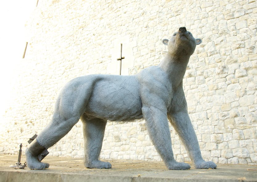 Sculpture of a polar bear made from galvanised wire.