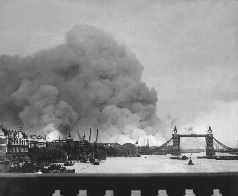 Large cloud of smoke over the London landscape - black and white photograph.