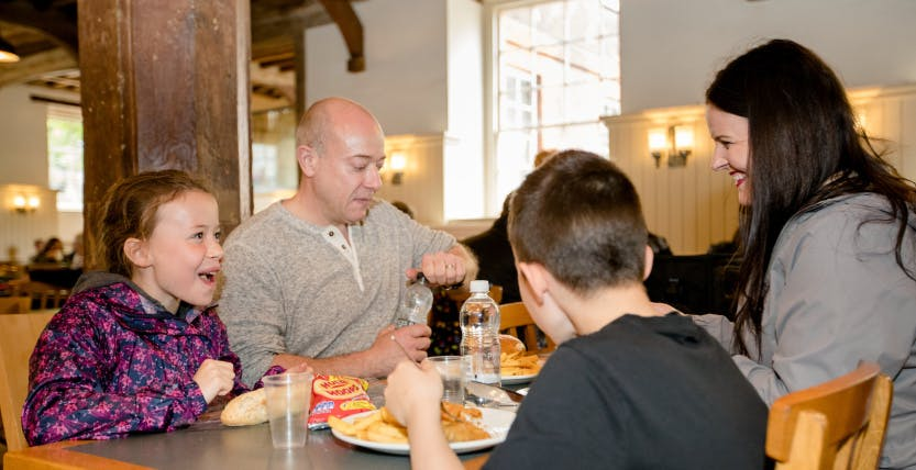 A family are shown eating in the New Armouries Café/Restaurant