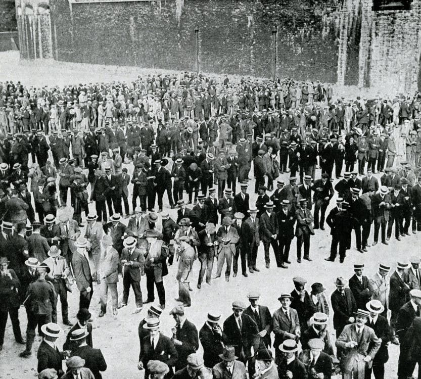 Young men answering the call to enlist at the start of the First World War. All of them employees of City firms, they were joining the City of London Battalion, consisting of 1300 men. Seen here at the Tower of London, waiting to swear the oath of allegiance.