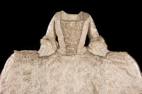 The Rockingham mantua. Silk satin dress on black background.