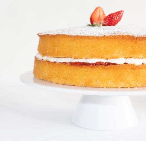 Victoria sponge cake on a display stand