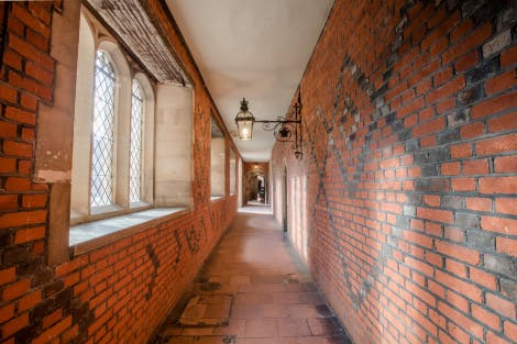 Wilson's Passage, looking south. The walls on either side of the passage are decorated with back vitrified bricks laid in diagonal patterns.