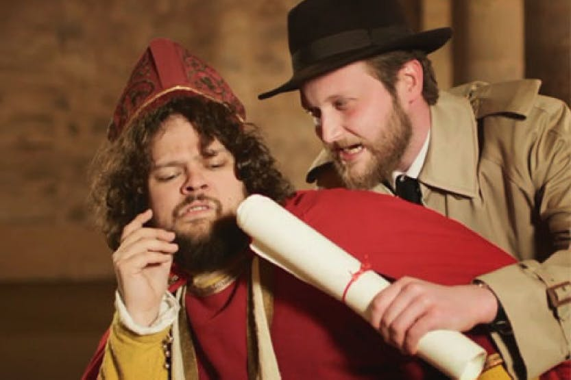 Fictional history reporter from 'The Scoop' video series interrogates a bishop at the Tower of London