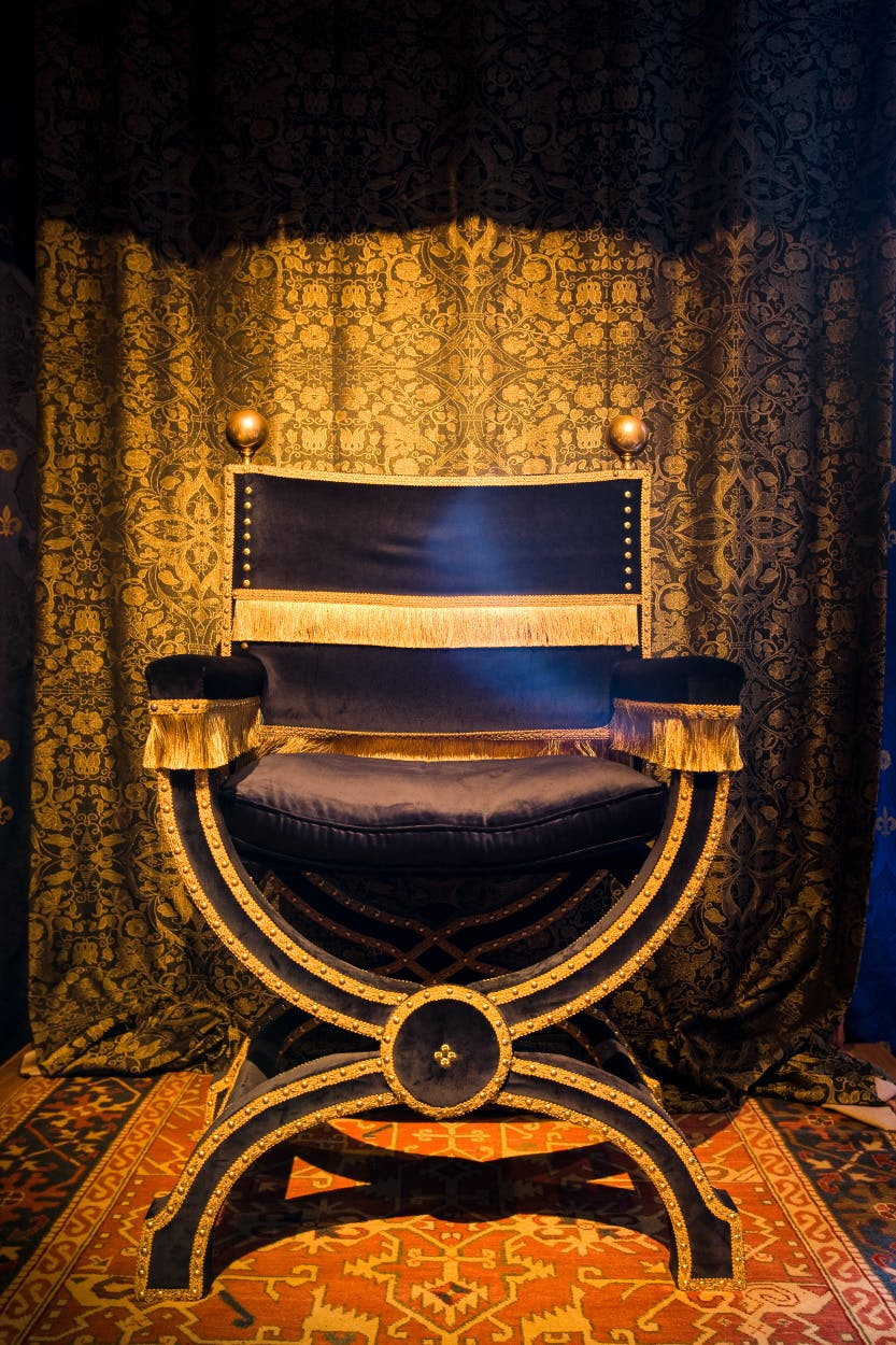 The Council Chamber looking east. Showing the throne upholstered in black and gold, part of the re-created setting for the Tudor chamber.