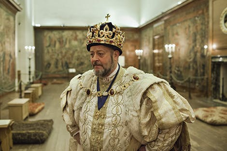 Live interpreter Richard Evans, in the role of King Henry VIII, in the Great Watching Chamber.
