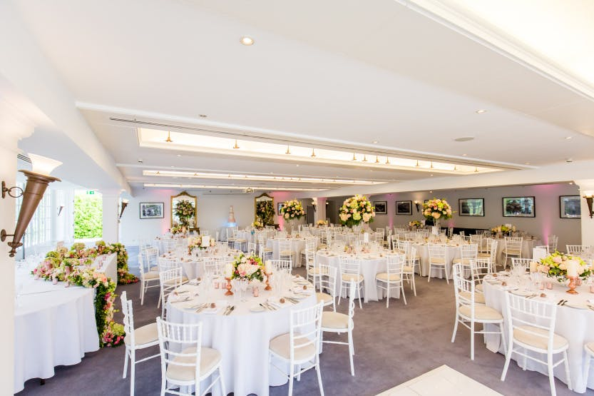 Wedding in the Garden Room with white chairs