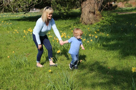 A grandmother and little boy in the Wilderness, surrounded by daffodils