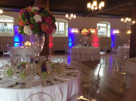 Dinner tables decorated with flowers in The New Armouries Banqueting Suite