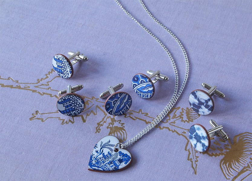 Blue and white necklace and cufflinks with pagoda design.