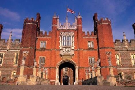 A ground level photo of the red brick Tudor west gate at Hampton Court Palace