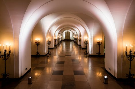 Arches lit by candlelight in the Undercroft of Banqueting House Whitehall, London