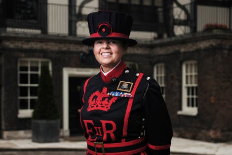 Yeoman Warder AJ Clark stands outside the Queen's House at the Tower of London