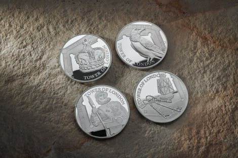 Four coins showing depicting iconic images from The Tower of London:  The Ravens, Yeoman Warder, Crown Jewels & Ceremony of the Keys.