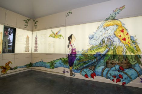 Illustration of a young girl and a blue and yellow dragon with Kew Pagoda in the background on a wall in an exhibition space