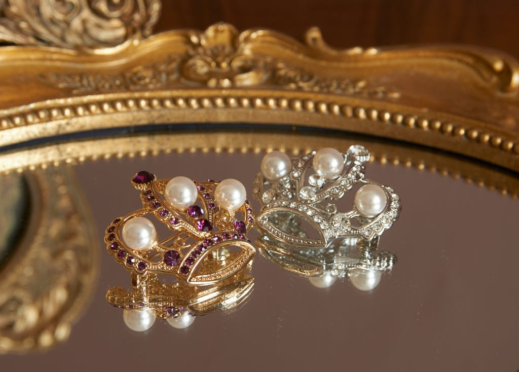 Lifestyle:  Swarovski pearl and amethyst silver crown brooch (30169174).  Swarovski pearl silver crown brooch (30169174) embellished with Swarovski pearls and crystals.
