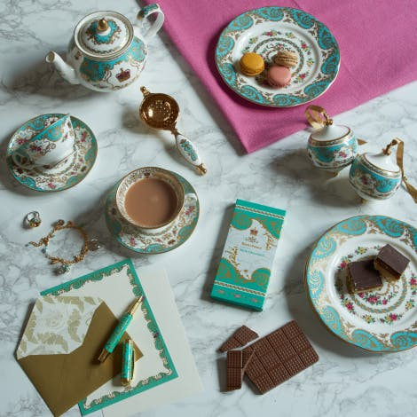 A selection of products from Royal Palace collection Royal Palace fine bone china dessert plate 30142978.  Royal Palace luxury ceramic bauble 30169631. Royal Palace fine bone china tea for two gift set 30162646 comprising of two cups and saucers and tea strainer, Royal Palace china tea po