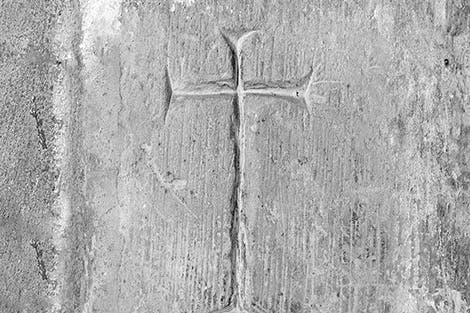 Cross-shaped graffiti carved into wall by a prisoner at Tower of London