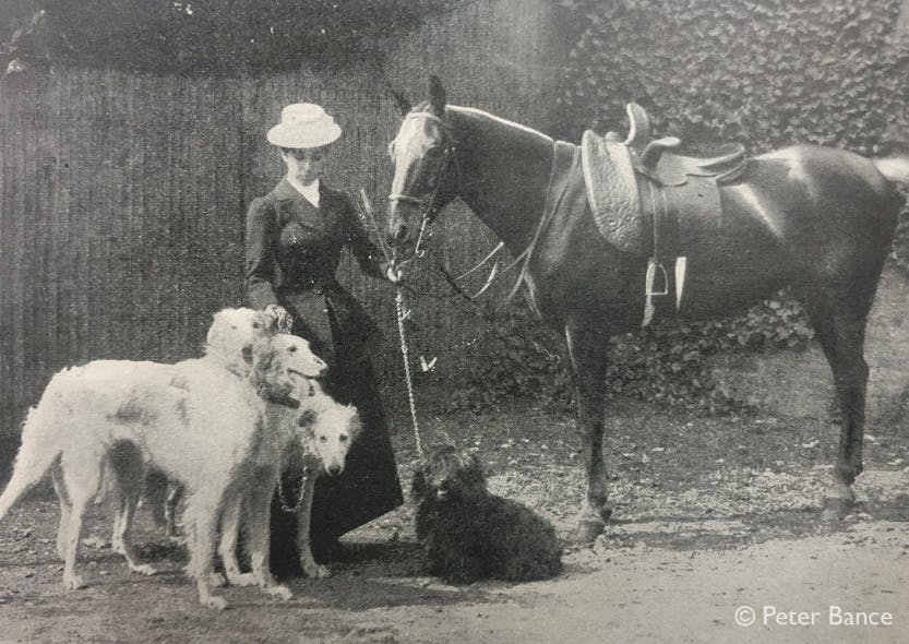 Black and white photograph showing Princess Sophia Duleep Singh with her horse and dogs.