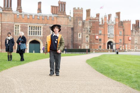 Student with special educational needs explores the West Front of Hampton Court Palace.