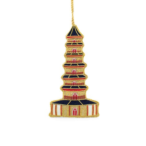 A handmade luxury Christmas tree ornament of the Kew Pagoda made from fabric and with tiny pearls woven into it