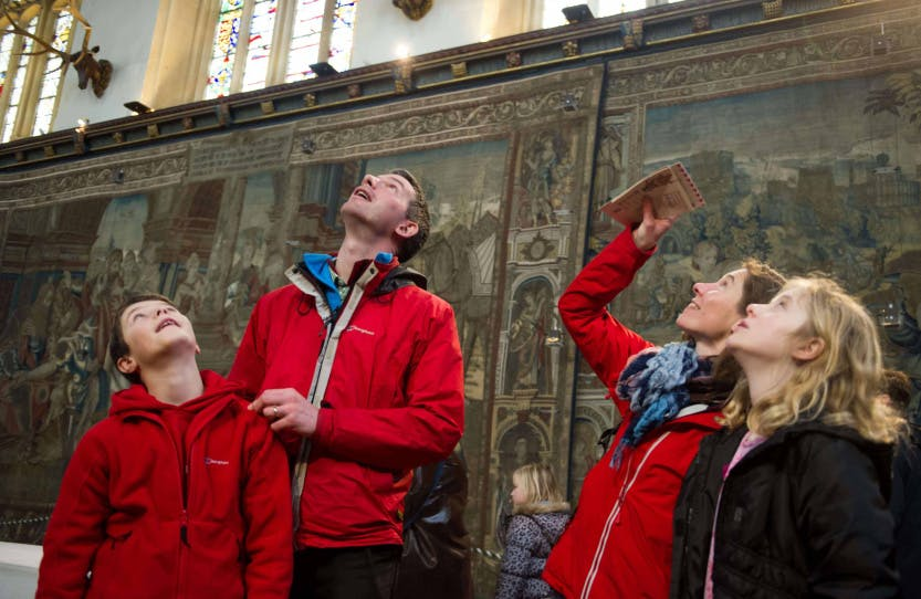 Photo of visitors taking part in one of the educational family activities offered at Hampton Court Palace