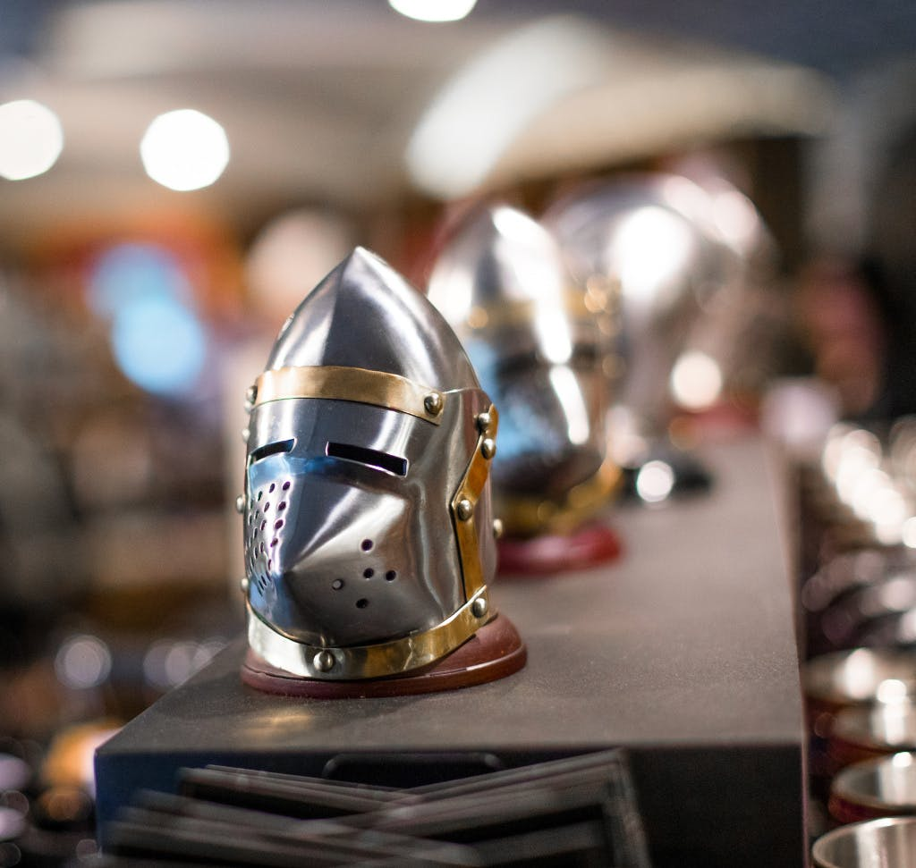 A close up view of the merchandise available in the Ravens shop.  Miniature versions of a helmet or visor from a suit or armour.
