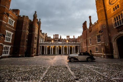 A wedding car parked in Clock Court at Hampton Court Palace