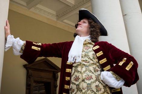 Georgian architect stood in Clock Court at Hampton Court Palace.