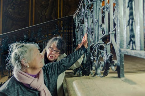 Blind person touching the King's Stairs Tijou bannisters.