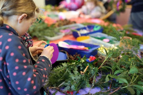 Child Christmas wreath making at the palace