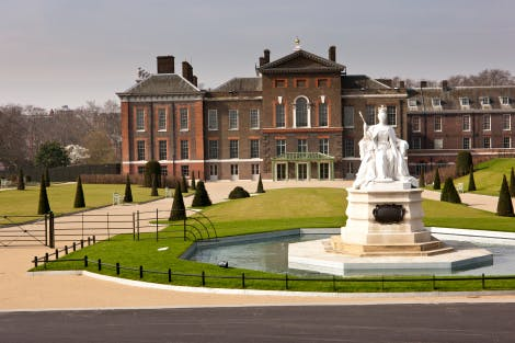 The East Front of Kensington Palace with a statue of Queen Victoria outside.