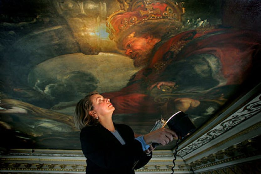 Close up of a conservator looking at Ruben's painted ceiling