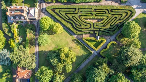 Aerial photograph of The Maze at Hampton Court Palace showing part  of the Wilderness and Wilderness Cottage