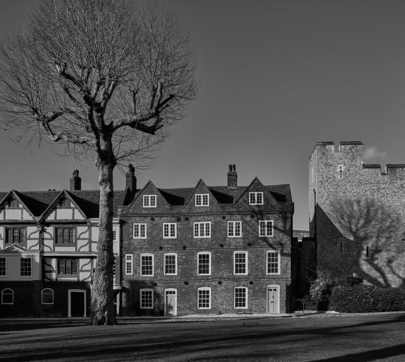 No 4 Tower Green and No 5 Tower Green. Looking west, 25 January 2018. Showing the Beauchamp Tower on the right of the image and part of the Queen's House on the left of the image.