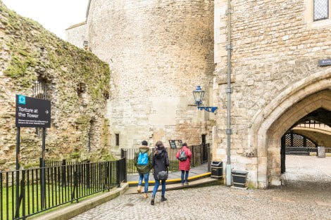 The Wakefield Tower and the Bloody Tower Arches with visitors walking towards the Torture at the Tower exhibition.