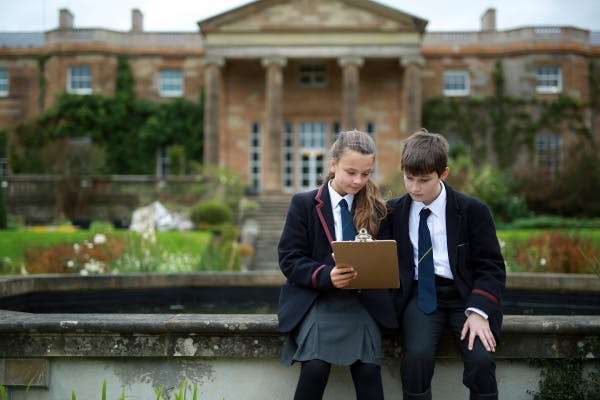 KS3 students doing a task during a Geography school session in the gardens at Hillsborough Castle.