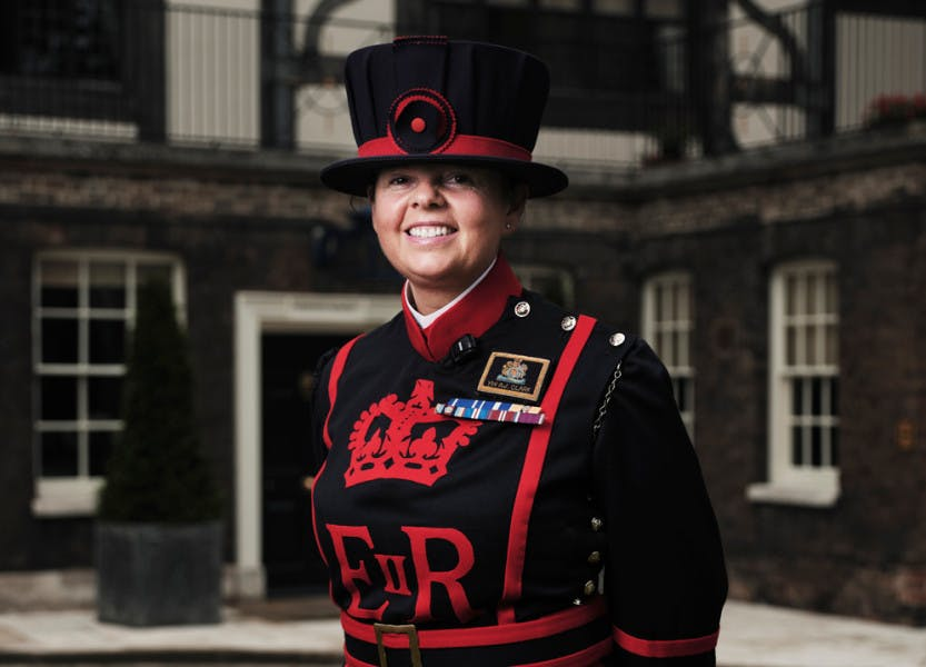 Yeoman Warder AJ Clark stands outside the Queen's House at the Tower of London, in uniform, for Inside the Tower of London series 2