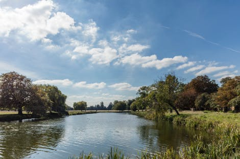 Home Park, showing Hampton Wick Pond. Showing a wide expanse of the lake and banks on either side.