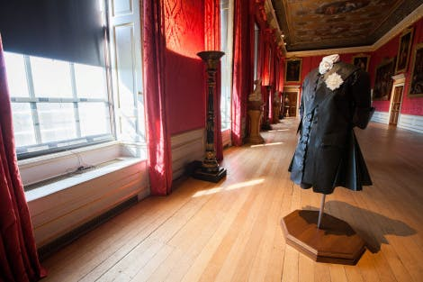 The King's Gallery, looking south-west. Showing a Tyvek mannequin figure on a pedestal dressed in black, representing King George II following the death of his wife, Queen Caroline.