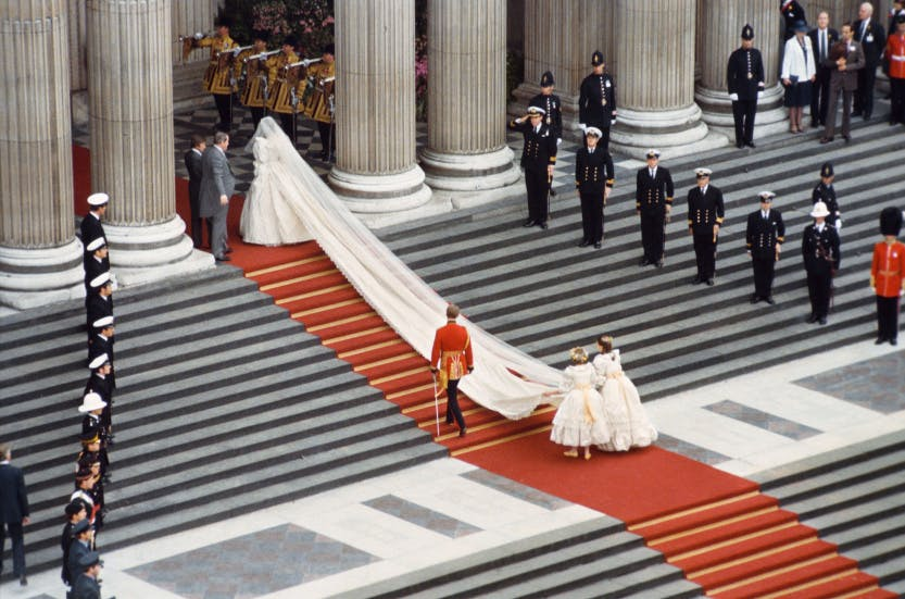 Lady Diana Spencer arrives at St Pauls Catherdral with train of dress streaming behind her, Photograph