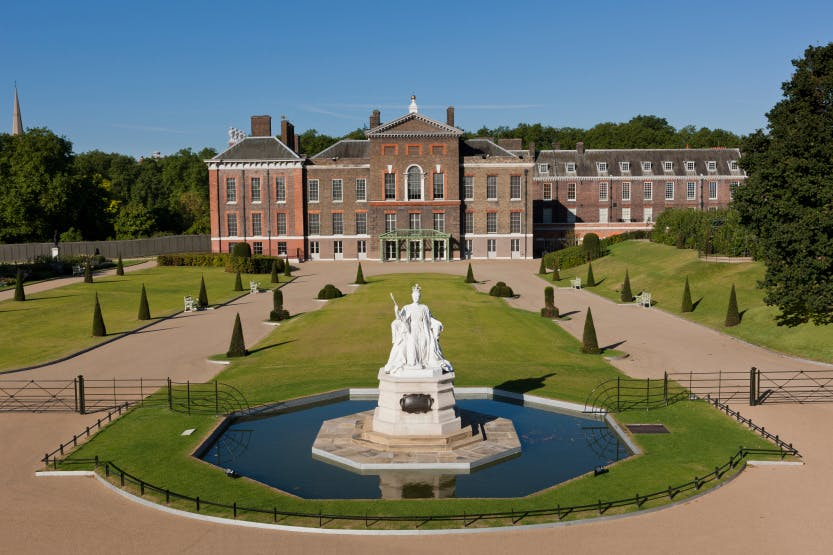 Photograph of Kensington Palace from the East Front garden with Queen Victoria's statue.