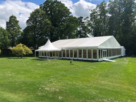 A marquee for 300 people set on the South Lawn Marquee Site. The marquee features a pagoda entrance and access is over the stone-flagged South Lawn Terrace.