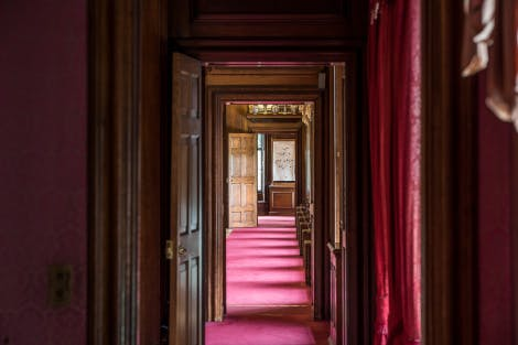 The Queen's Drawing Room, looking north through the doorway along the red-carpeted enfilade.