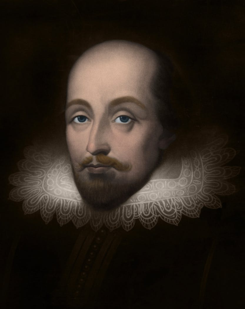 A portrait of Sir Walter Raleigh with his face and ruff illuminated against a dark background.