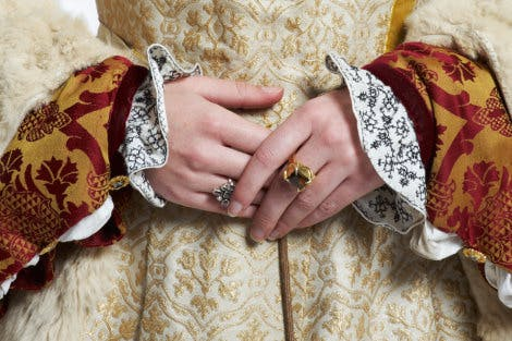 A reconstruction of a Tudor ensemble detail, c1530s. Showing the bodice of a gold and white gown. The fabric is especially woven to replicate surviving Tudor fabrics.