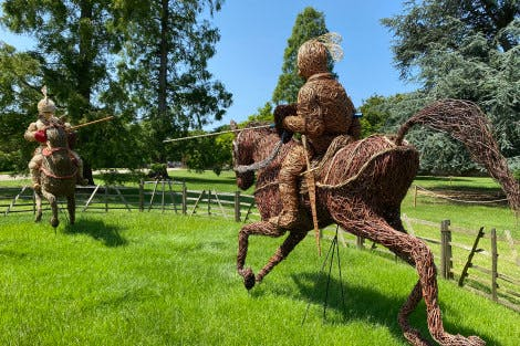 Figures made from wicker in a jousting pose.