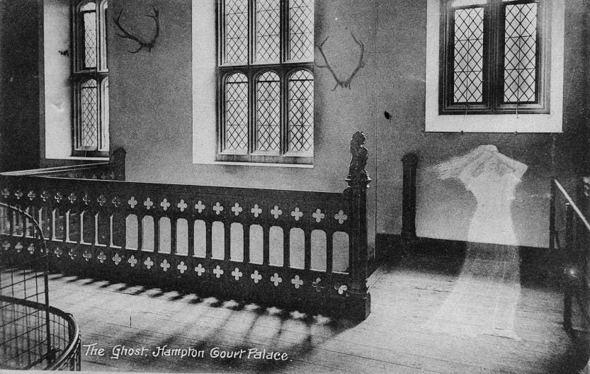 An early postcard depicting a 'ghost' in the Horn Room. The ghost is that of King Henry VIII's fifth wife, Catherine Howard. Charged with adultery, the young queen was placed under house arrest at Hampton Court. The story goes that she managed to escape from her rooms and run to the Chapel where the King was at Mass. Before she was able to reach him, she was seized by the guards and dragged screaming back to her rooms. It is said that her ghost still haunts the palace today.