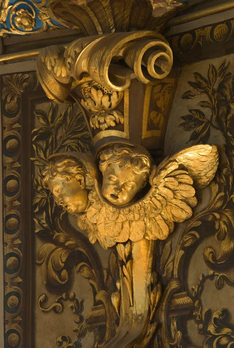 The Chapel Royal.  Detail showing a carved and gilded console bracket with cherubs' heads.